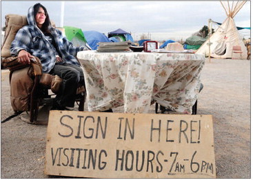The sign-in desk at Camp Hope