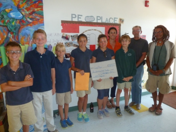 6th and 7th graders present Nicole James and Matt their donation
