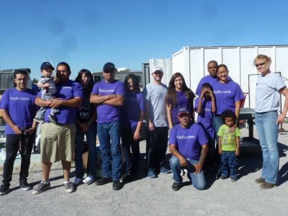 Volunteers from FedEx Help Organize Our Storage Containers